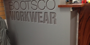 Maroochydore-Bootsco-Workwear-reception-desk-signage-wall-wrap-desk-wrap